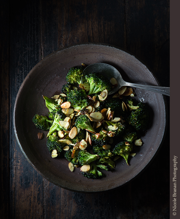 Broccoli florets tossed in a bit of oil, seasoned with salt, pepper and curry powder and roasted until tender, then sprinkled with a hint of lemon juice and toasted almonds  – a great side dish!