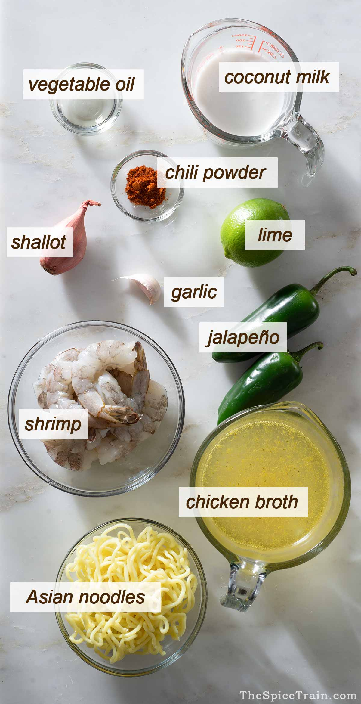 Ingredients for coconut shrimp soup on a kitchen counter.