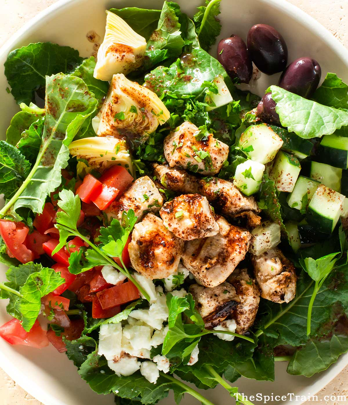 Closeup of a grilled chicken salad with sumac dressing.