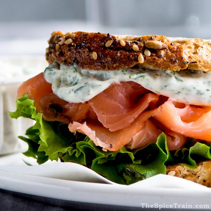 Smoked salmon panini with lettuce and dill mayonnaise.
