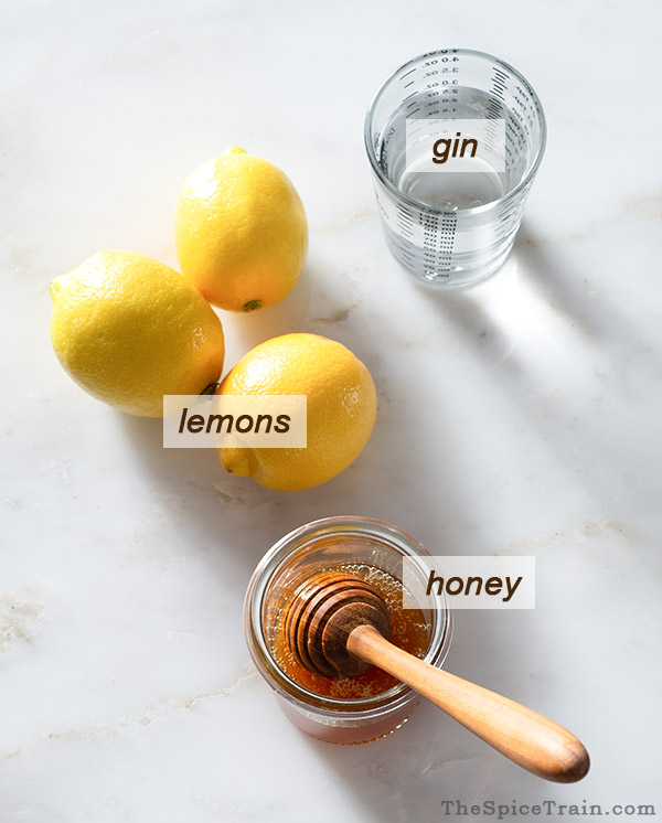 All ingredients needed to make a bee's knees cocktail.