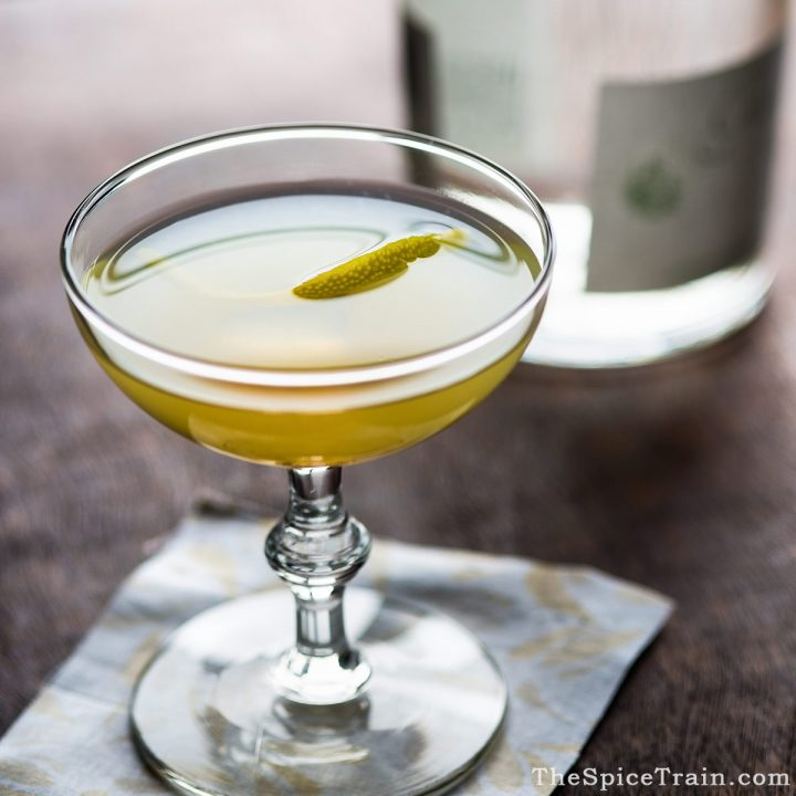 A bee's knees drink with a lemon twist.