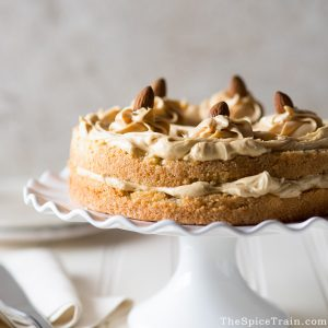 A two layer almond cake with caramel frosting and almonds.