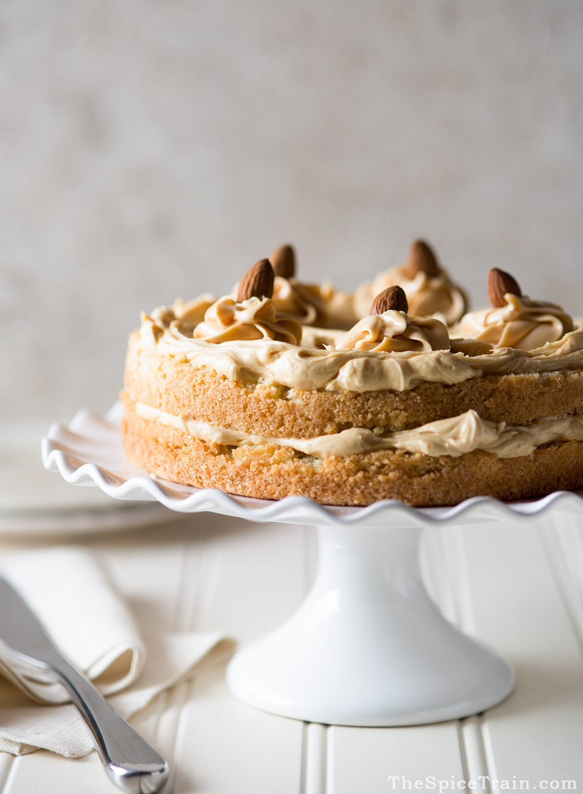 A two layer butter almond cake with caramel frosting.