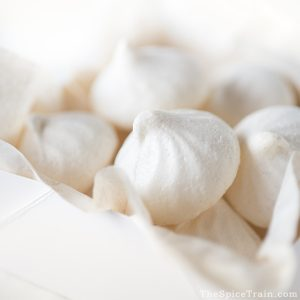 Closeup of a box filled with meringue cookies.