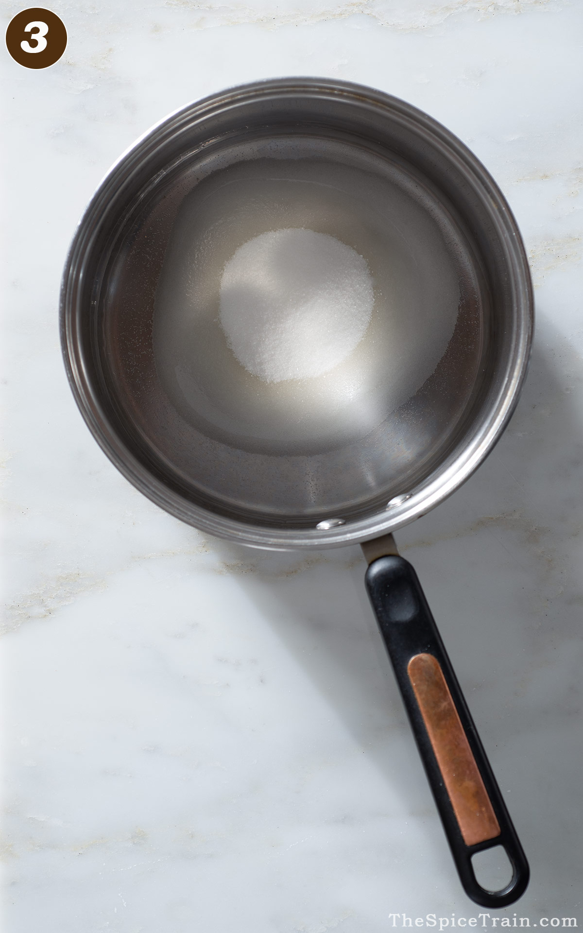 A large saucepan with water and sugar.