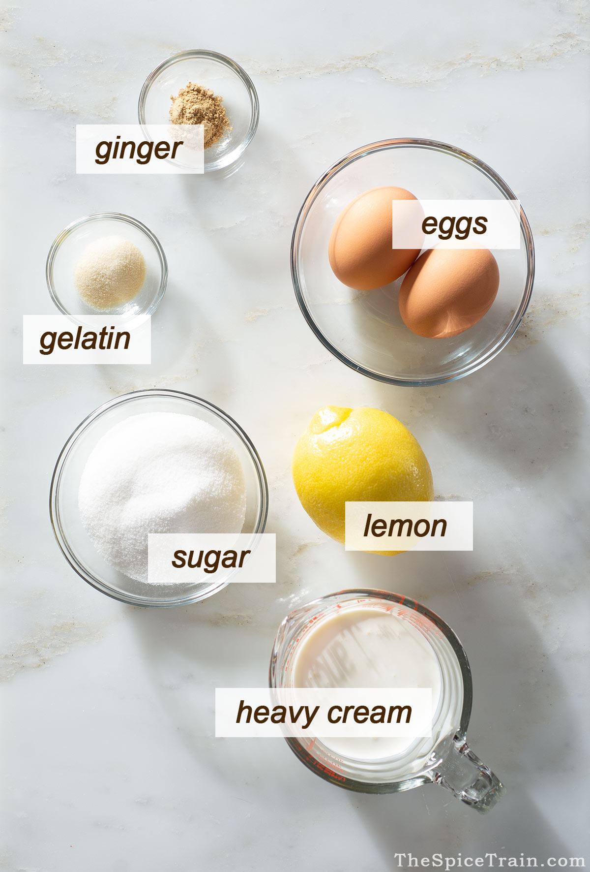 All ingredients needed to make lemon ginger mousse.