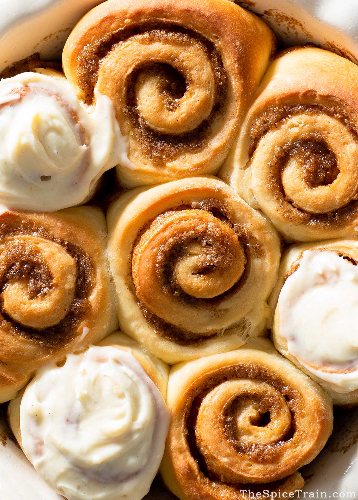 Freshly baked cinnamon rolls with cream cheese frosting.