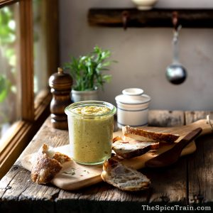 A rustic kitchen with a jar of homemade mustard on a wooden table.