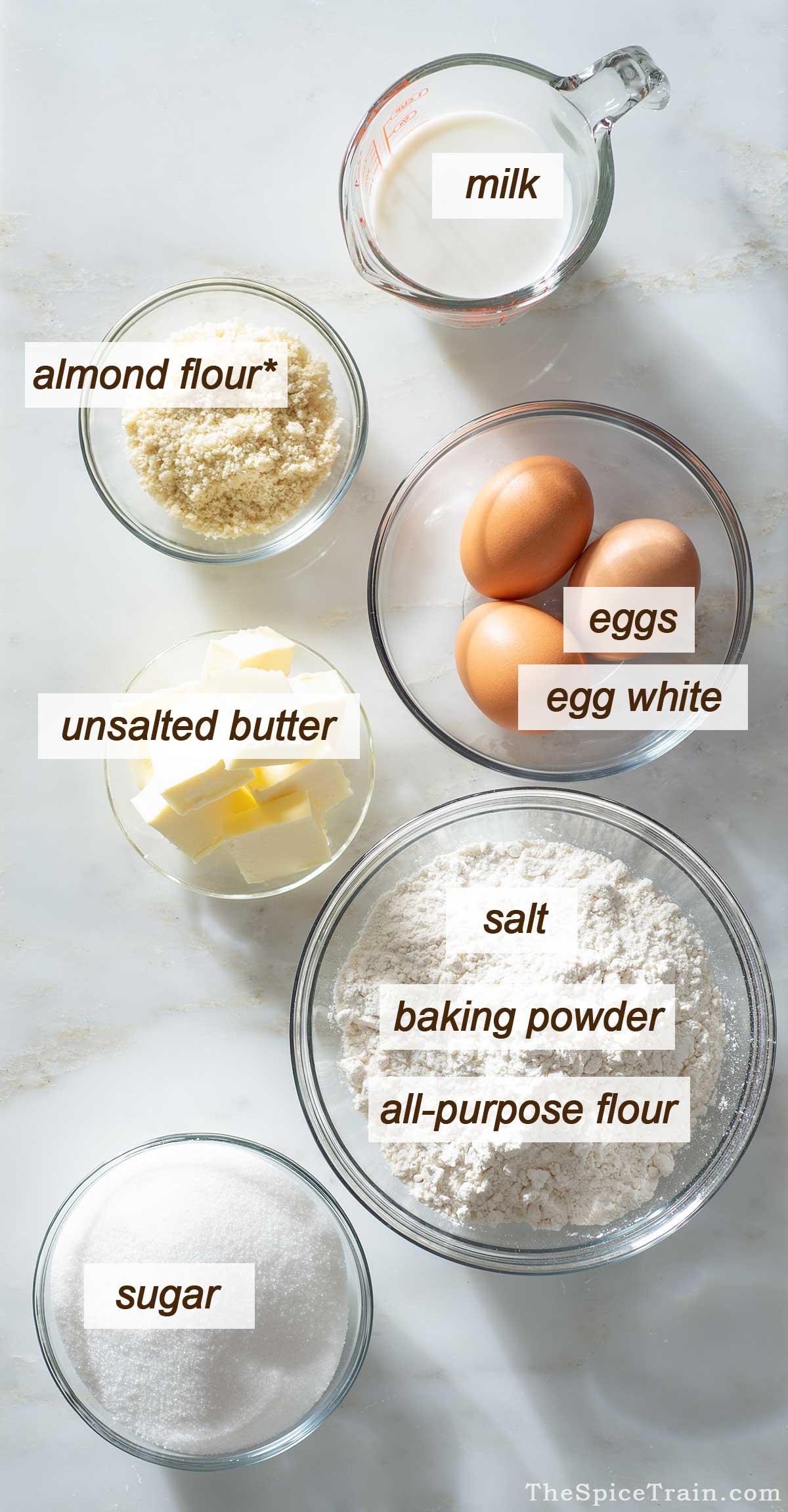 All ingredients needed to make almond cake.