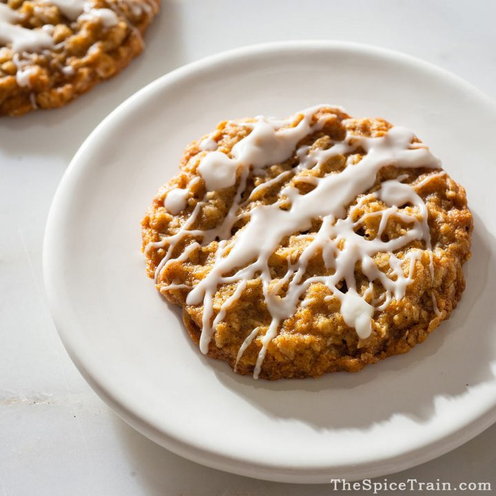 Closeup view of a large oatmeal coconut cookie.