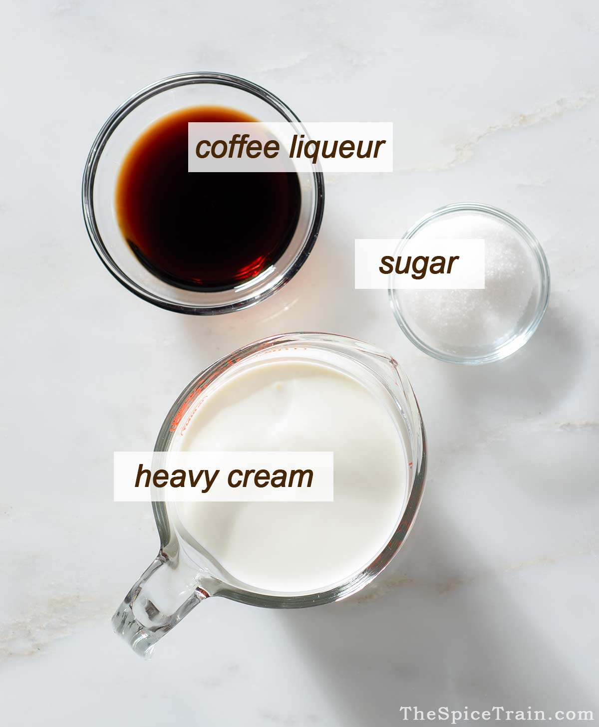 All ingredients needed to make coffee whipped cream filling.
