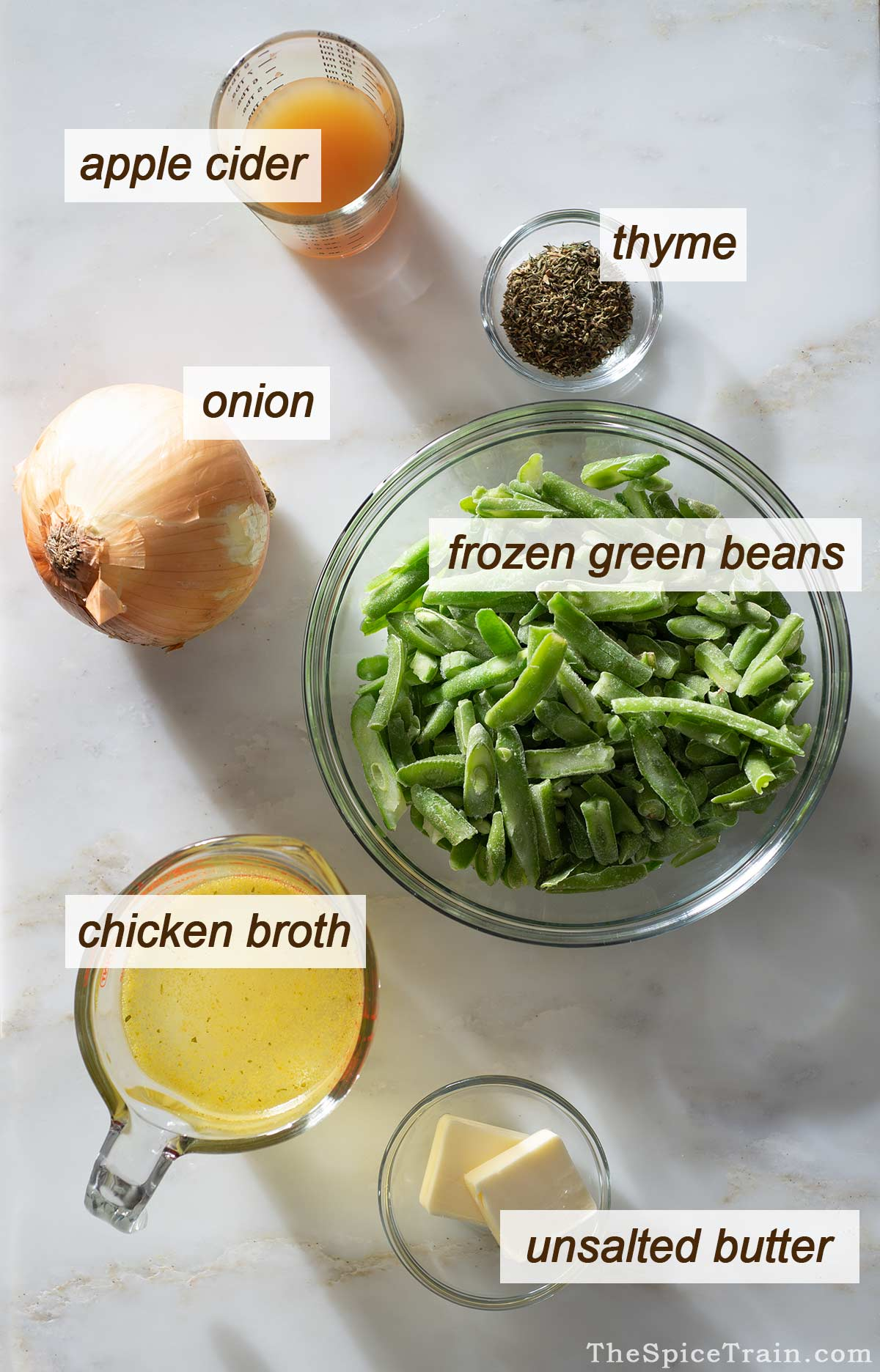 Green bean side dish ingredients on a kitchen counter.