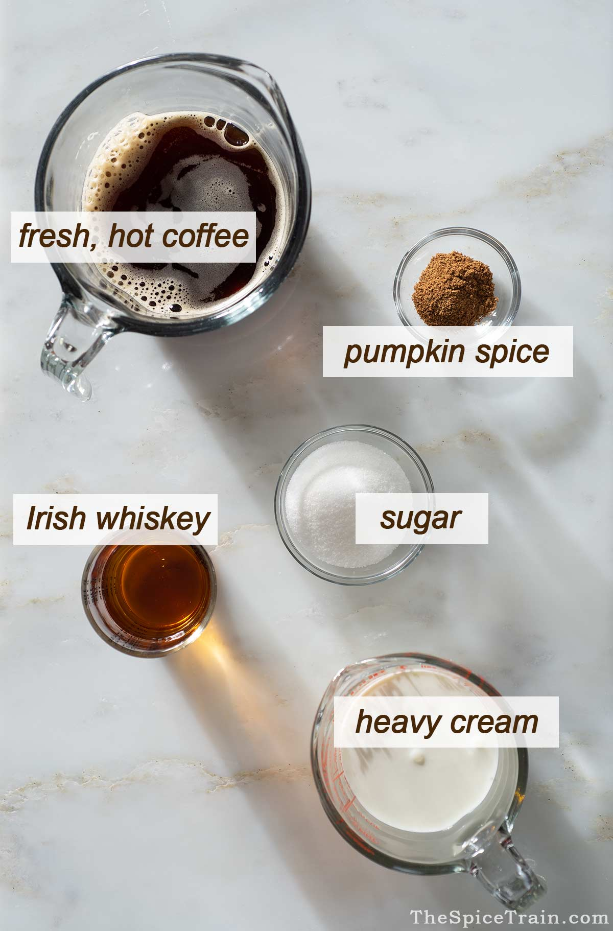 Ingredients for spiced Irish coffee on a kitchen counter.