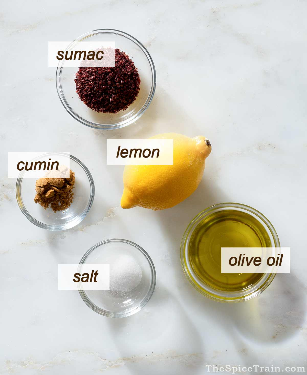 Sumac dressing ingredients on a kitchen counter.