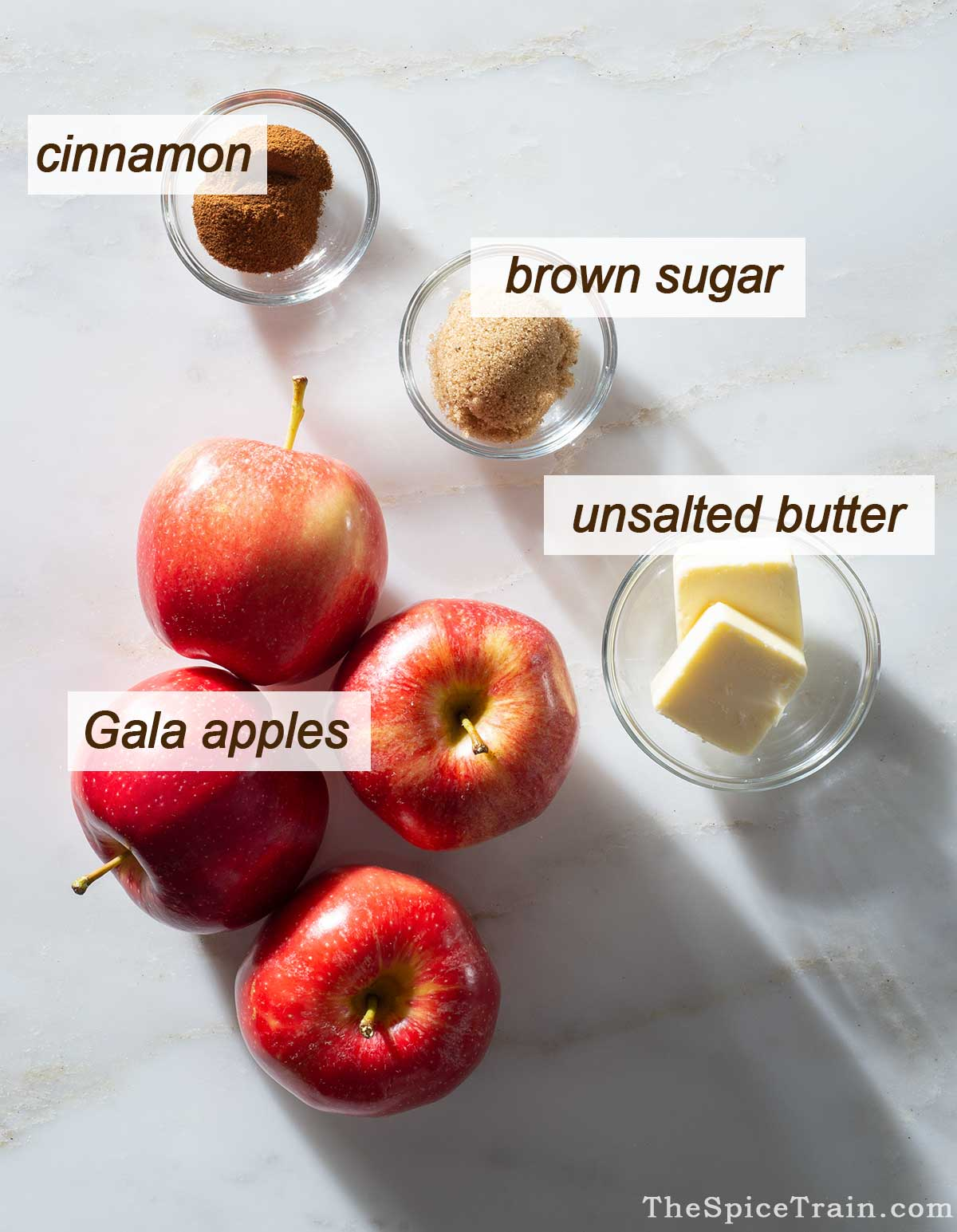 Stovetop apple crisp ingredients on a kitchen counter.