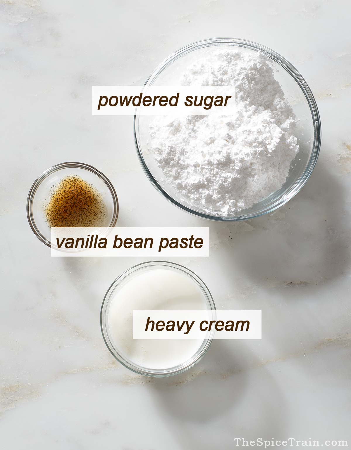 Vanilla icing ingredients on a kitchen counter.