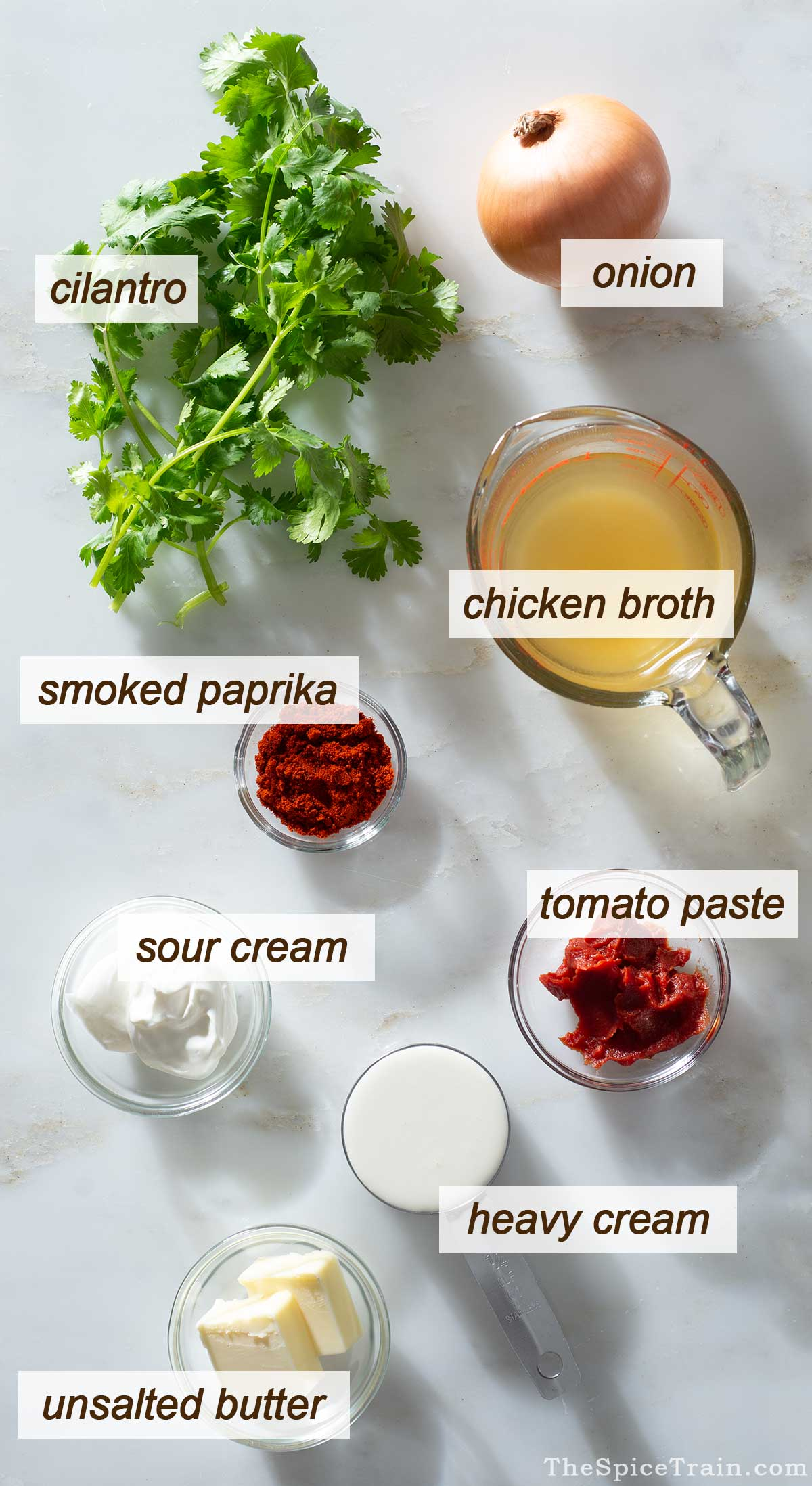 Paprika sauce ingredients on a kitchen counter.