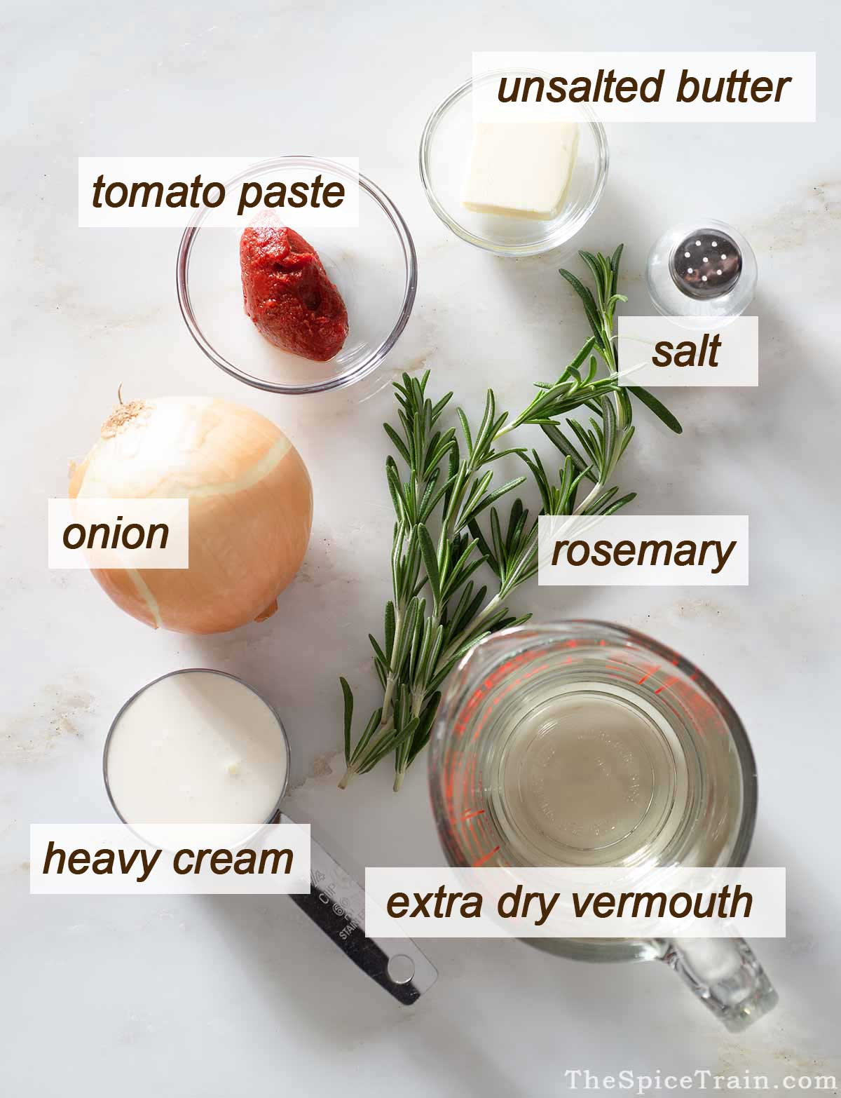 Rosemary tomato cream sauce ingredients on a kitchen counter.