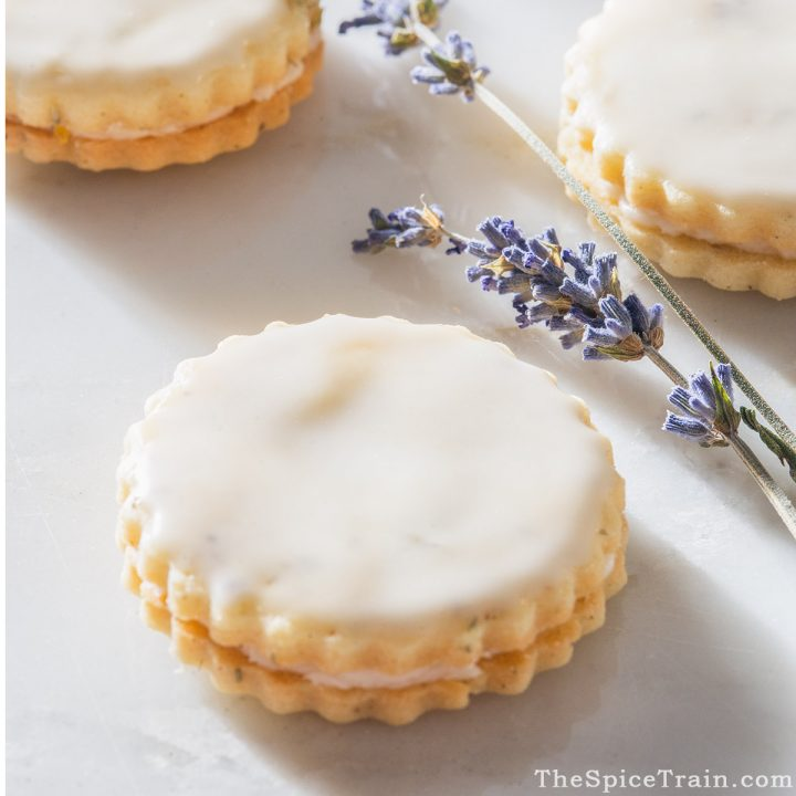 Closeup of sandwich cookies with dried lavender.