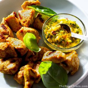 Curry-marinated grilled chicken with mango basil sauce.