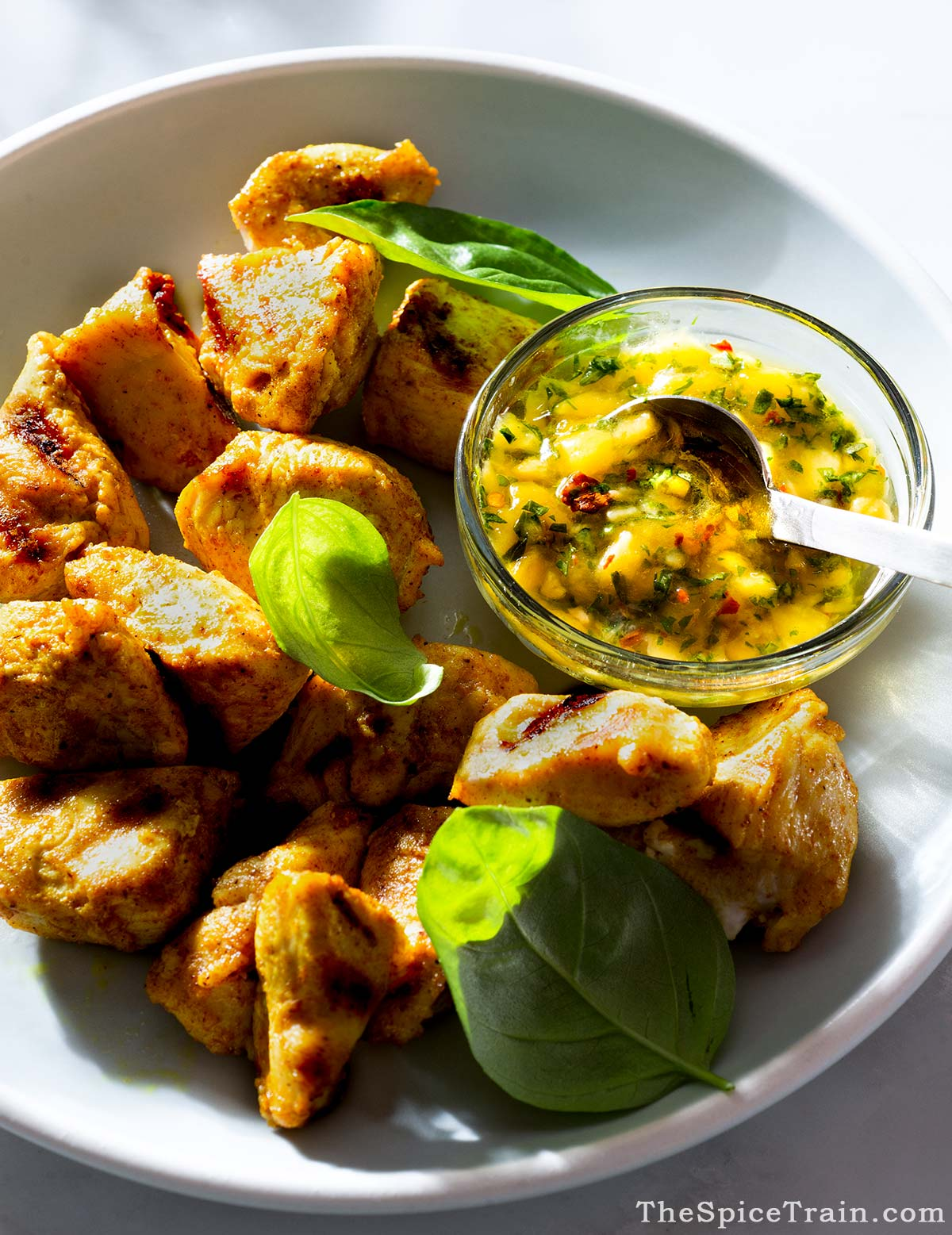 Curry-marinated grilled chicken chunks with mango basil sauce.