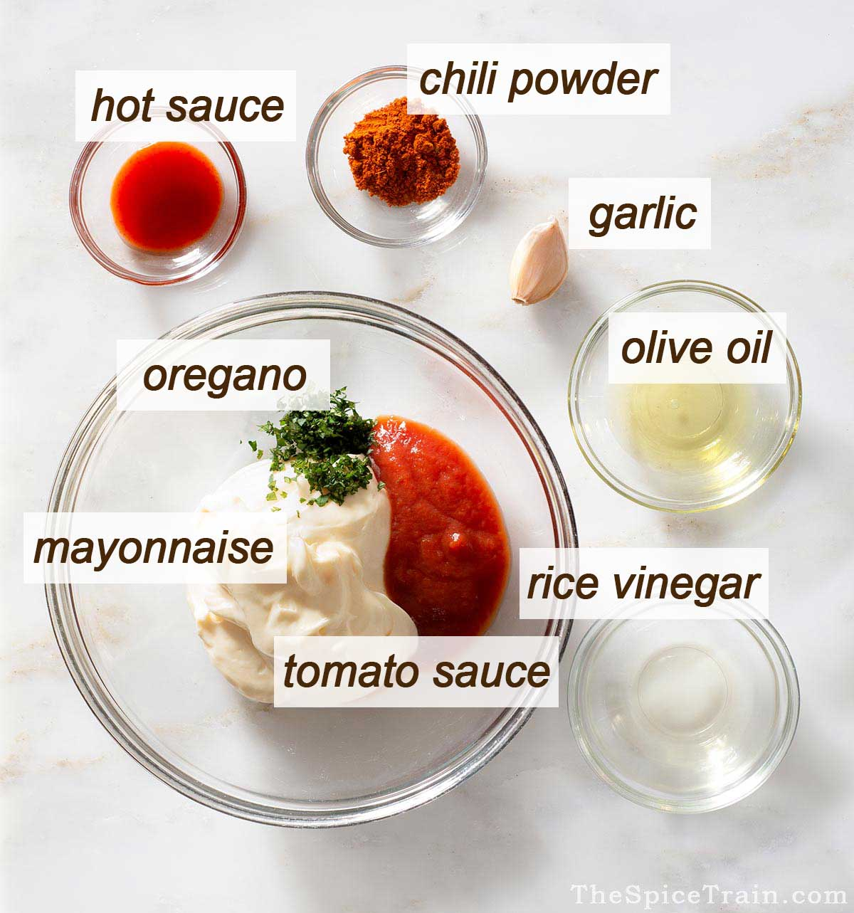 Spicy burger sauce ingredients on a kitchen counter.
