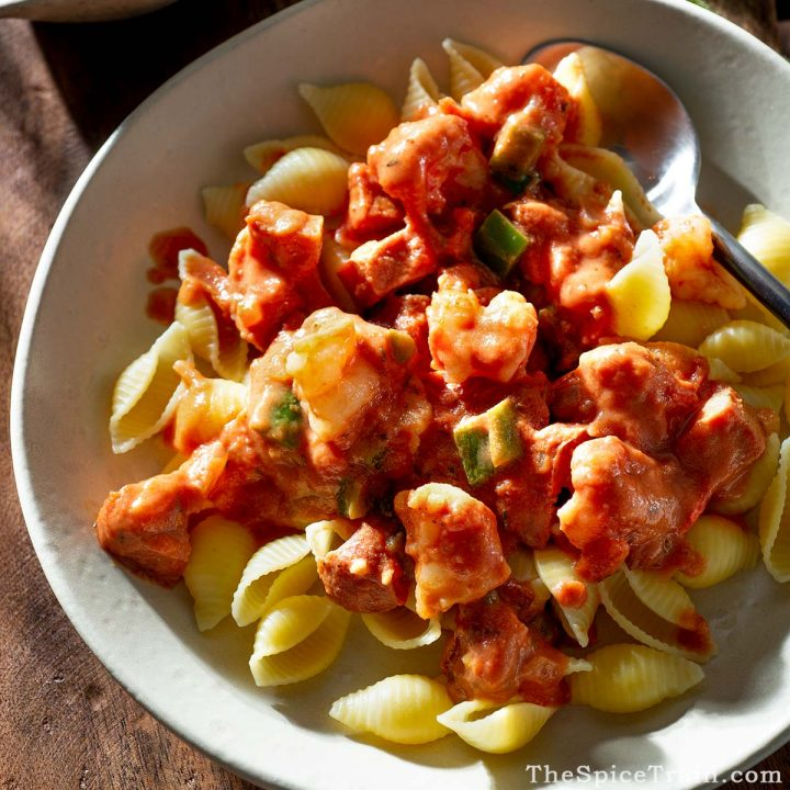 Pasta with shrimp and sausage tomato sauce on a plate.