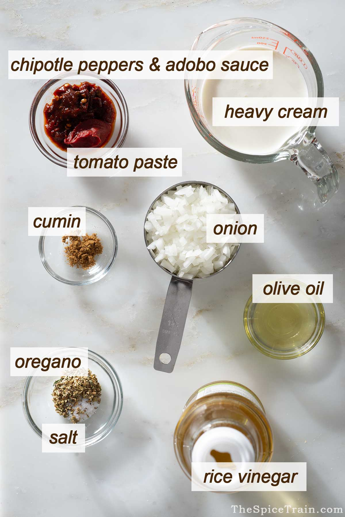 Chipotle sauce ingredients on a kitchen counter.