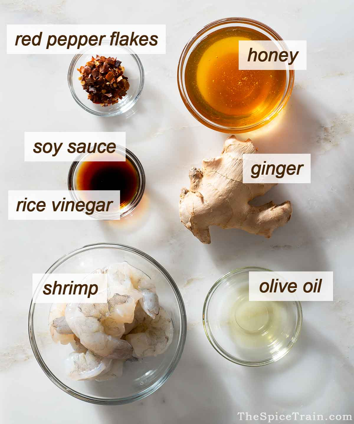 Sweet and spicy shrimp ingredients on a kitchen counter.